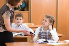 Teacher confiscating schoolkid`s mobile phone at lesson Stock Images
