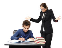 Teacher confused at what the student is writing in his notebook Stock Images