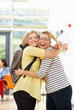 Teacher Congratulating Pupil On Successful Exam Result Stock Photography