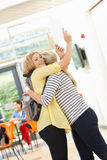 Teacher Congratulating Pupil On Successful Exam Result. And Smiling Stock Images