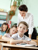 Teacher controls the task performing Royalty Free Stock Image