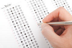 Teacher correct test. Teacher correct the test (questionnaire). Top view royalty free stock photography