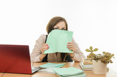 The teacher covered his face with a notebook Royalty Free Stock Image