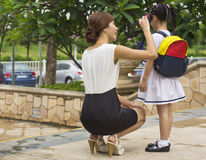 Teacher & daughter Stock Images