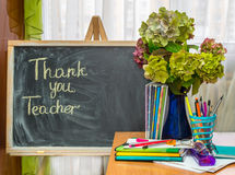 Teacher  Day. Hydrangea flowers and copybooks on the teacher's d Stock Photo