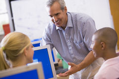 IT teacher demonstrating in class Royalty Free Stock Images