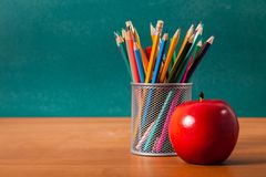 Teacher. Desk apple school pen chalkboard blank royalty free stock photo