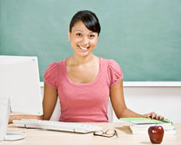 Teacher at desk in classroom Royalty Free Stock Photos