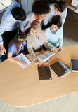 Teacher Discussing With Students At Desk In Stock Photos
