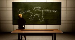 Teacher thinking about concealed carry and school safety. Teacher drawing a gun on the chalkboard Stock Photo