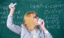Teacher eats piece of paper absorb information. Teacher ready to eat her paperwork. Woman teacher eats crumpled piece of. Paper chalkboard background. Thirst of stock images