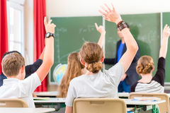 Teacher  educate or teaching a class of  pupils in school Stock Photo