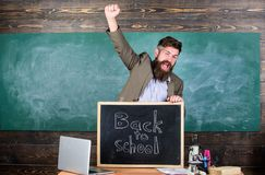 Teacher or educator welcomes inscription back to school. Full of energy after summer school holidays. Welcome back to. School. Teacher educator welcomes new stock photo