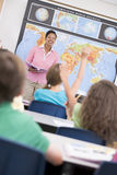 Teacher in elementary school geography class Stock Image