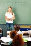 Teacher in elementary school thinking Stock Photo