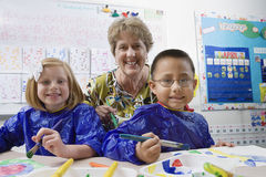 Teacher And Elementary Students Royalty Free Stock Photo
