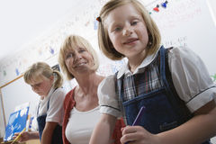 Teacher And Elementary Students Royalty Free Stock Images