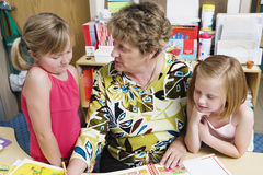 Teacher With Elementary Students Stock Image