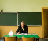 Teacher in empty classroom Stock Photography