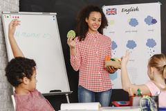 Teacher and english classes. Young pretty women as a teacher on english classes Stock Image