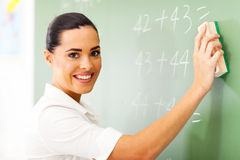 Teacher erasing chalkboard Royalty Free Stock Image