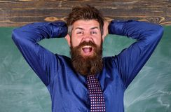 Teacher etiquette tips modern education professional. Man bearded teacher or educator hold head chalkboard background stock image