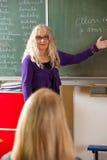 Teacher explaining Royalty Free Stock Photos