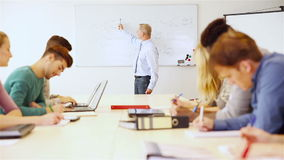 Teacher explaining business economics Stock Image