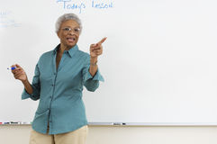 Teacher Explaining In The Classroom Stock Photo