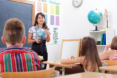 Teacher explaining about Earth globe Royalty Free Stock Photo