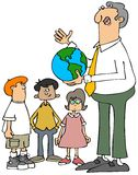 Teacher explaining the earth to students Stock Photo