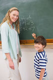Teacher explaining mathematics to a pupil Royalty Free Stock Images