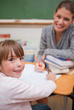 A teacher explaining something to her pupil Stock Image