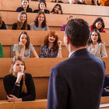 Teacher explaining something to students Royalty Free Stock Photos