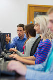 Teacher explaining to students in the computer room Stock Photography