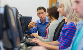 Teacher explaining to students in the computer room Royalty Free Stock Images