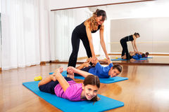 Teacher explaining young boys fitness exercises to balance the body Stock Photography