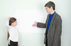 Teacher explains something to the schoolgirl Royalty Free Stock Images