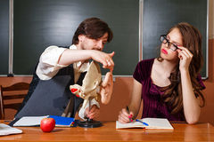 Teacher explains structure of pupil of human ear. Male student teacher explains the structure of the human ear. Anatomy Lesson. The concept of modern education Stock Photo