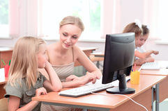 Teacher explains the task schoolgirl Stock Photography