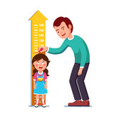 Teacher or father measuring girl kid height. Kindergarten teacher or father measuring girl kid height with painted graduations on the wall arrow. Flat style Stock Photography