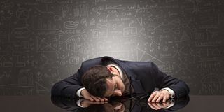 Teacher fell asleep at his workplace with full draw blackboard c. Elegant teacher fell asleep at his workplace with full draw blackboard concept royalty free stock images