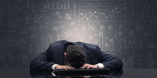 Teacher fell asleep at his workplace with full draw blackboard concept. Elegant teacher fell asleep at his workplace with full draw blackboard concept stock images
