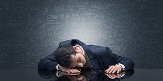 Teacher fell asleep at his workplace with full draw blackboard concept. Elegant teacher fell asleep at his workplace with full draw blackboard conceptn royalty free stock images