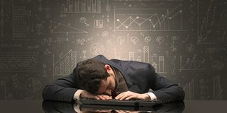Teacher fell asleep at his workplace with full draw blackboard concept. Elegant teacher fell asleep at his workplace with full draw blackboard concept stock image