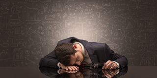 Teacher fell asleep at his workplace with full draw blackboard concept. Elegant teacher fell asleep at his workplace with full draw blackboard concept stock photography