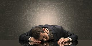 Teacher fell asleep at his workplace with full draw blackboard concept. Elegant teacher fell asleep at his workplace with full draw blackboard conceptn stock image