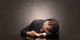 Teacher fell asleep at his workplace with full draw blackboard concept. Elegant teacher fell asleep at his workplace with full draw blackboard concept royalty free stock photos