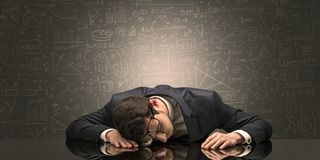 Teacher fell asleep at his workplace with full draw blackboard concept. Elegant teacher fell asleep at his workplace with full draw blackboard concept royalty free stock images