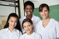 Teacher And Female Students In Science Lab Stock Photos